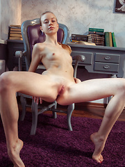Kimberly Kace displays her slender body, long legs and pink pussy on the chair. - Pics