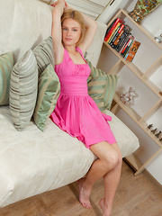 Xena sensually strips on the sofa baring her pink nipples and pink pussy. - Pics