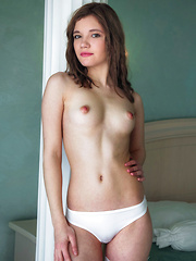 Carrie strips on the bed as she bares her perky tits and sweet pussy. - Pics