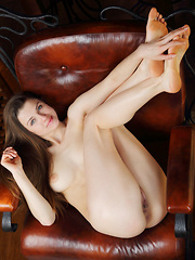 Pandora B strips on the chair baring her delectable pussy and gorgeous body.