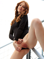 Redhead Alice May shows off her pink pussy on the stairs. - Pics
