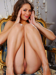 Olya Fey strips on the chair as she bares her slender body and smooth pussy. - Pics