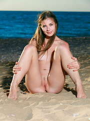 Vivian flaunts her nubile body and sweet pussy on the sandy shore. - Pics