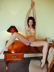 Ardelia A shows off her sexy, tight body on the sofa. - Pics