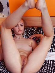 Eidis strips on the bed as she spreads her legs wide open baring her sweet pussy. - Pics