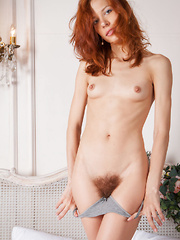 Dennie sensually poses on the bed baring her unshaven pussy. - Pics