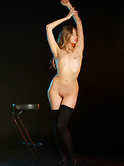 Top model Nimfa bares her sexy, tight body and sweet pussy on the chair. - Pics