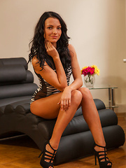 Sapphira A sensually strips on the lounge as she flaunts her delectable pussy. - Pics