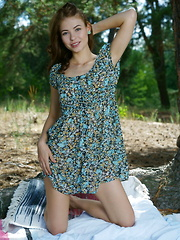 Hilary C sensually strips outdoors as she bares her delectable body. - Pics
