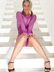 Nikki posing in sexy purple dress - Pics
