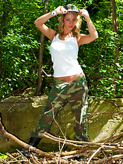 Nikki put on military uniform and poses in the woods