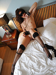 Skinny girl in stockings acts in a hot fetish scene - Pics