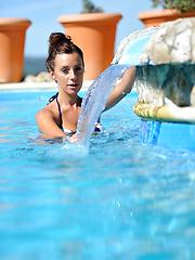 Portugalian girl Tori posing near pool