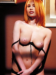 Redhead hottie Anya in black bra and pantys