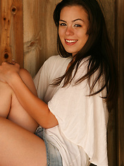 Abby gets rowdy on a hay bale with her denim mini skirt!