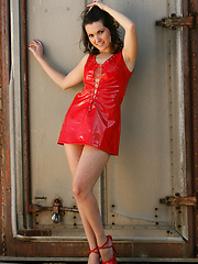 Carmen peels out of her ultra sexy red vinyl dress