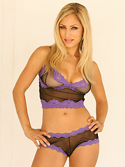 Carolyn Michelle teases in her black and purple see thru lingerie