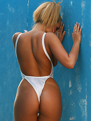 Peeling off her silver bodythong down to nothing at all  - Pics