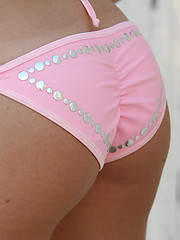 Ashley loves to tease us in her cute little pink bikini! - Pics