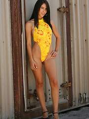 Cassie channels the sun gods in her hot yellow and orange one piece