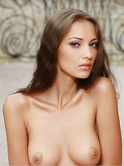 Delightful erotic charmer with a gorgeous figure, perfectly round boobs, and long, slender legs. - Pics