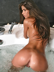 Nessa has a tanned and lean body and in this installment she is in the hot tub and it just gets hotter. - Pics