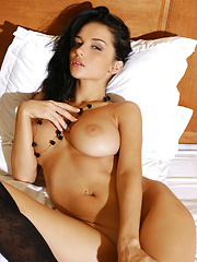 Dark hair and large natural breast on this goddess will have you coming back all night. - Pics