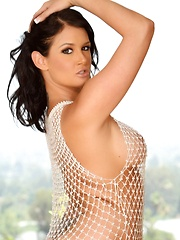 Busty brunette babe, Tory Lane, poses in nothing but her white mesh dress and heels. She gets so turned on she just has to touch her amazing body and smooth pussy! - Pics