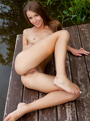 The beautiful Lina Diamond delivers a   gorgeous erotic outdoor shoot, strip   teasing her black and white stripe   shirt and poses on the dock by the   river. - Pics