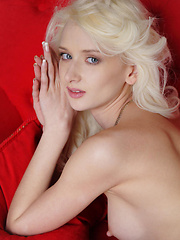 With the red sofa Nika's alluringly fresh looks stands out with her evenly-toned complexion, long, slender build, ultra sexy legs and round, firm assets. - Pics