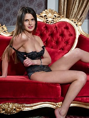 Layla offers a titillating series   full of elegant and stylized   captures as she strips her sleek   black dress on the sofa.