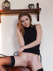 Seductive stunner Katie delights   her fans as she strips her ultra-  sexy black dress with fishnet   stockings to showcase her   delightfully petite but enticing   body. - Pics