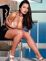 Aria Giovanni - shows off her famous curves and beautiful face