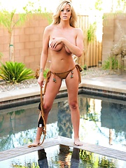 xoGisele is picture perfect in her tan bikini by the pool as she strips down and moves her body to music - Pics
