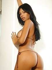 Karla Spice teases you in her tiny tan bikini - Pics