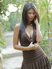 Karla Spice models her little brown dress but soon takes it off - Pics