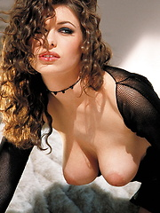 Ginger Jolie - Laying in furs in black top and skirt - Pics
