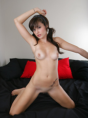 Babe with pigtails gets naked - Pics