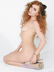 Lexi Belle strips off a tiny skirt and revealing top - Pics