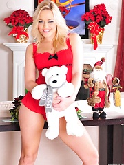 Alexis Texas wearing only a Santa hat