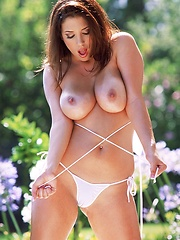 Jelena Jensen - splashes her naturals curves in the pool - Pics