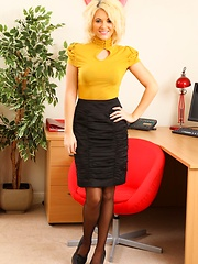 Blonde Emma in yellow office wear and black suspenders - Pics