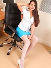 Leggy Chelsea strips on the desk in blue mini skirt - Pics