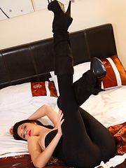 Natalie slips out of the sexy black leggings and revealing top to show off her beautiful long legs - Pics