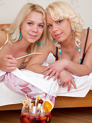 Three marvelous blonde lesbian teens stripping and showing their naughty shaved pussies. - Pics