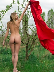 Tayra A playfully posing with a bright red fabric wrapped around her delicate, naked body - Pics