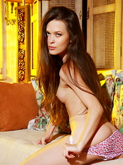 Stunning blue eyes with hypnotizing gaze, Amelie B will set your heart and fantasies on fire as she sensually strips off her meager clothing and starts flirting naked in front of the camera. - Pics