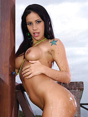 Latina babe outside stripping in shower