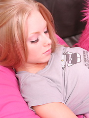 Petite blonde teen Skye shows off her pink panties as she teases on the couch - Pics