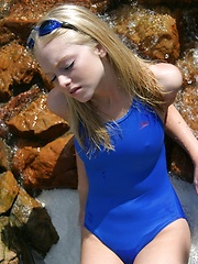 Blonde teen Skye shows off her tight little body at the pool in a tight one piece bathing suit - Pics